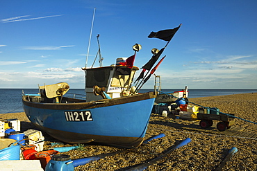 Fishing boat and nets on the seafront shingle beach of this popular unspoiled seaside town, Aldeburgh, Suffolk, England, United Kingdom, Europe