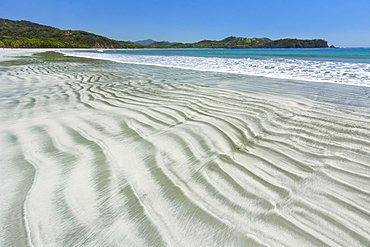 Bands of light sand grains sorted from heavier dark minerals in intertidal zone at Playa Carrillo, Nicoya Peninsula, Costa Rica, Central America