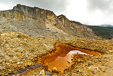 Mineral stained pond on collapsed flank of Papandayan Volcano, an active four crater caldera, Garut, West Java, Java, Indonesia, Southeast Asia, Asia