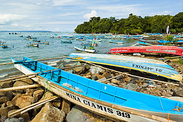 Outrigger fishing boats on the east side of the isthmus at this south coast resort town, Pangandaran, West Java, Java, Indonesia, Southeast Asia, Asia