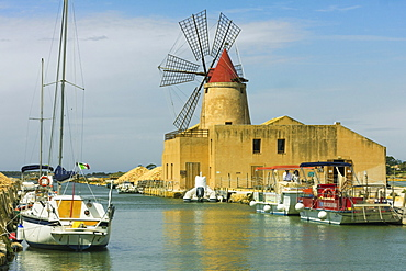 The 16th century windmill at the Ettore and Infersa Saltworks by the Stagnone Lagoon salt pan area south of Trapani, Marsala, Sicily, Italy, Mediterranean, Europe