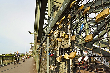 Cyclists padlocks on the Hohenzollern railway and pedestrian bridge over the River Rhine, Cologne, North Rhine-Westphalia, Germany, Europe