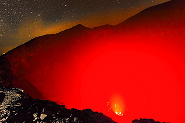 Glowing active 700m wide volcanic crater of Volcan Telica with lava vents far below, in the North West volcanic chain, Leon, Nicaragua, Central America
