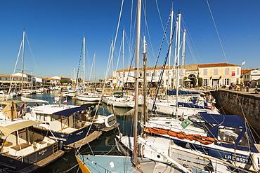Yachts moored at the Quai de Bernonville in this north coast town, Saint Martin de Re, Ile de Re, Charente-Maritime, France, Europe