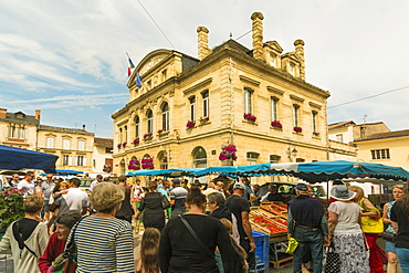 Stalls and the Mairie in town hall square on market day in this old bastide town, Sainte-Foy-la-Grande, Gironde, Aquitaine, France, Europe