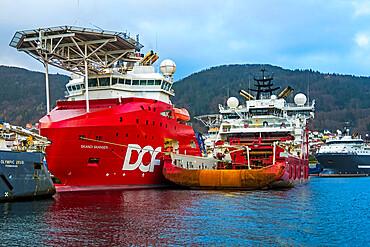 Skandi Skansen helicopter supply ship & other offshore energy industry support vessels, Vagen Harbour. Bergen, Hordaland, Norway