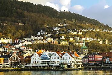 The castellated Kjottbasaren shopping centre on left and the Fjord Restaurant on the Bryggen waterfront, UNESCO World Heritage Site, Bergen, Hordaland, Norway, Scandinavia, Europe