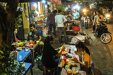 People eating street food at stalls near the riverfront,city centre, Phnom Penh, Cambodia, Indochina, Southeast Asia, Asia