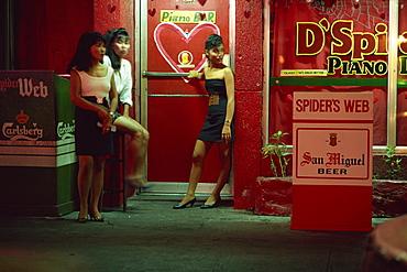 Doorgirls at nightclub entrance in hotel and nightclub district of Ermita, Manila, Philippines, Southeast Asia, Asia