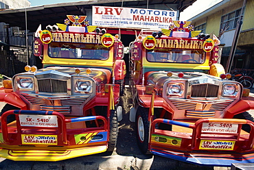 Pair of customised Jeepney trucks, the ubiquitous national transport, Bacolod City, Philippines, Southeast Asia, Asia