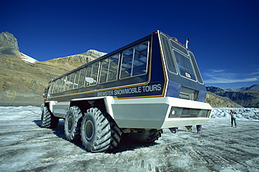 Snowmobile that takes tourists onto the Athabasca Glacier in Jasper National Park in the Rocky Mountains in British Columbia, Canada, North America