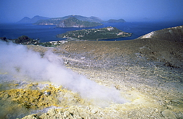 Steam issuing from sulphurous fumarole at Gran Craters, Vulcano Island, with islands of Lipari and Salina beyond, Aeolian Islands (Eolian Islands) (Lipari Islands), UNESCO World Heritage Site, Sicily, Italy, Mediterranean, Europe