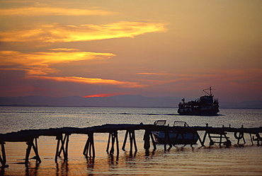 Jetty and ferry at sunset at Moyogalpa in the west of Omotepe Island, Lake Nicaragua, Nicaragua, Central America