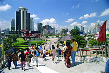 Street scene of pedestrian walkway in the centre of Shenzhen City in the Special Economic Zone boomtown on border with Hong Kong, China, Asia