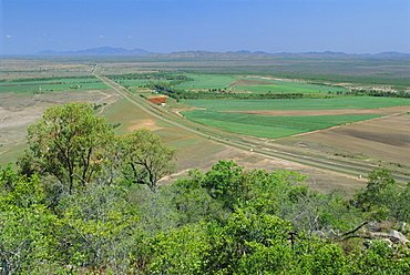 Sugar cane and other crops by the Bruce Highway south of Townsville, Queensland, Australia