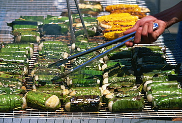 Sticky rice wrapped in banana leaves on barbecue at Vietnamese Lunar New Year Festival in Footscray, a suburb of Melbourne, Victoria, Australia, Pacific