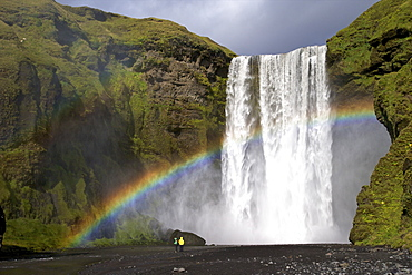 Skogafoss waterfall with rainbow in summer sunshine, South coast, Iceland, Polar Regions