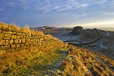 Sunrise and Hadrian's Wall National Trail in winter, looking to Housesteads Fort, Hadrian's Wall, UNESCO World Heritage Site, Northumberland, England, United Kingdom, Europe