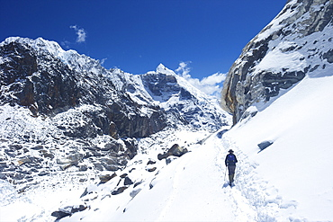 Trekker walking over Cho La Pass with Lobuche West and East on left side, Solukhumbu District, Nepal, Himalayas, Asia