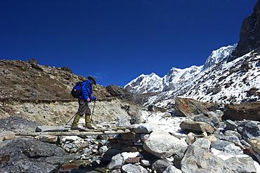 Trekker crossing the Chola Khola valley near Dzonglha, Solukhumbu District, Sagarmatha National Park, UNESCO World Heritage Site, Nepal, Himalayas, Asia