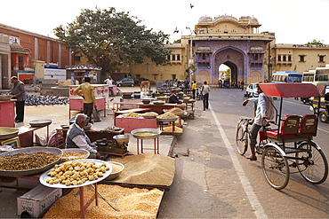 Sellers of pigeon food outside gates of City Palace, Jaipur, Rajasthan, India, Asia