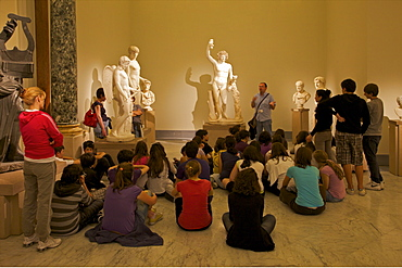 Schoolchildren learning about Roman sculpture at the National Archaeological Museum in Naples, Campania, Italy, Europe