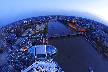 View of passenger pod capsule, Houses of Parliament, Big Ben and the River Thames from the London Eye at dusk, London, England, United Kingdom, Europe