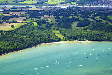 Aerial view of yachts racing in Cowes Week on the Solent, with Osborne House in background, Isle of Wight, England, United Kingdom, Europe