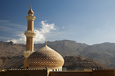Sultan Quaboos Mosque with mountains and cloud at back, Nizwa, Oman, Middle East