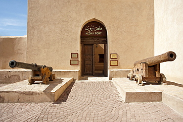 Entrance to the fort of Nizwa with two cannons, Oman, Middle East