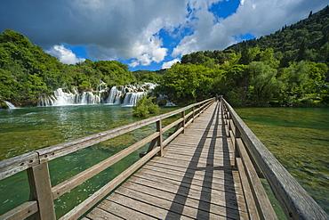 Wooden bridge and waterfalls in Krka National Park, aeibenik-Knin County, Croatia, Europe