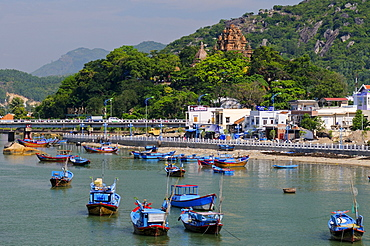 Fishing boats, Port of Nha Trang on the Cai river, in the back the Po Nagar temple, Vietnam, Southeast Asia
