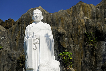 Buddha statue in front of rocks, landmark in Nha Trang, Vietnam, Southeast Asia