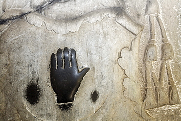 Magic black hand on a weathered grave slab in the cloister, former monastery of St. Viktor, Xanten, Lower Rhine region, North Rhine-Westphalia, Germany, Europe