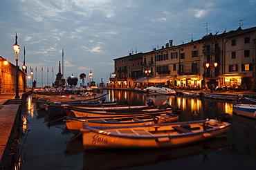 Night shot, fishing boats in the harbor in Lazise, Lake Garda, Lago di Garda, Veneto, Northern Italy, Europe