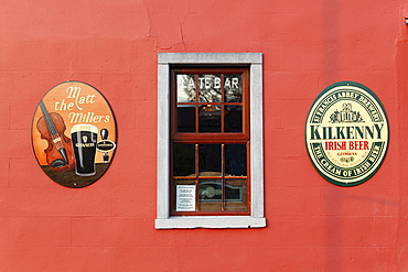 Outer wall of a pub, Matt the Miller, emblems of Guinness beer and St. Francis Abbey Brewery, Kilkenny, County Kilkenny, Ireland, British Isles, Europe