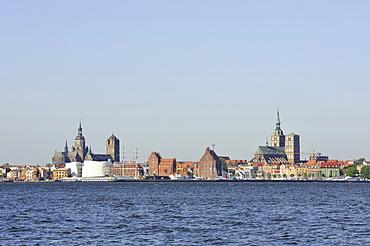 View from Ruegen island over the Strelasund sound on the skyline of the Hanseatic city of Stralsund, Mecklenburg-Western Pomerania, Germany, Europe