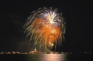 Fireworks on the shores of Lake Constance with the city of Radolfzell and the Cathedral of Our Lady, Landkreis Konstanz county, Baden-Wuerttemberg, Germany, Europe