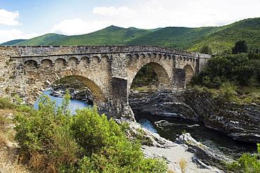 Old stone bridge over Tavignano river at Corte, Niolo, Corsica, France, Europe