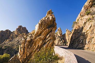 Road through red porphyry rocks, Calanche de Piana, Gulf of Porto, Corsica, France, Europe