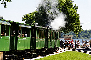 Chiemseebahn train and tourists, Prien Stock, lake Chiemsee, Chiemgau, Upper Bavaria, Germany, Europe
