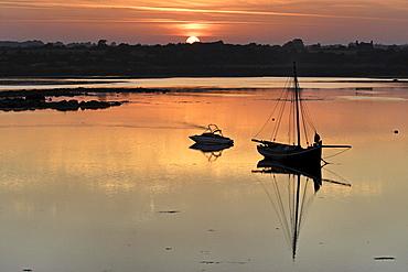 Boats and coastal sunrise, Kinvara, Republic of Ireland, Europe