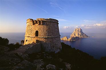Watchtower Torre del Pirata, Torre des Savinar on Cap del Jueu, view on Es Vedra island, Ibiza, Balearic Islands, Spain, Europe