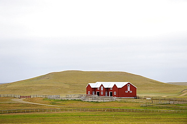 Red sheepshearers' shed in a hilly landscape, Ushuaia, Tierra del Fuego, Patagonia, Argentina, South America