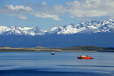 Red icebreaker on Beagle Channel, Ushuaia, Tierra del Fuego, Patagonia, Argentina, South America