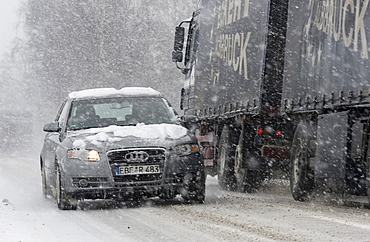 Cars driving on a highway through heavy snowfall in Markt Schwaben, Bavaria, Germany, Europe