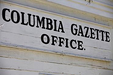Columbia Gazette Office, shield, historic Columbia State Park, California, USA