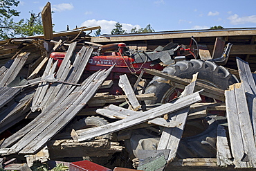 A farm shed collapsed on a tractor by a tornado, Dundee, Michigan, USA