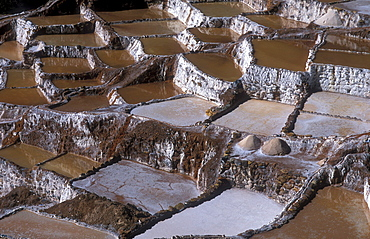 Salt production by evaporation on a mountain slope at Pichingote, the salt terraces were already in use during the time of the Incas, southern Peru, South America