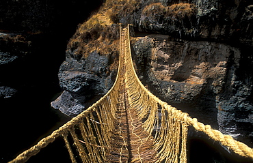 Queswachaka suspension bridge made from plant fibers, Ichu grass, over the Apurimac, Southern Peru, South America